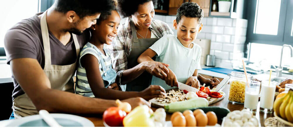 family cooking healthy food together