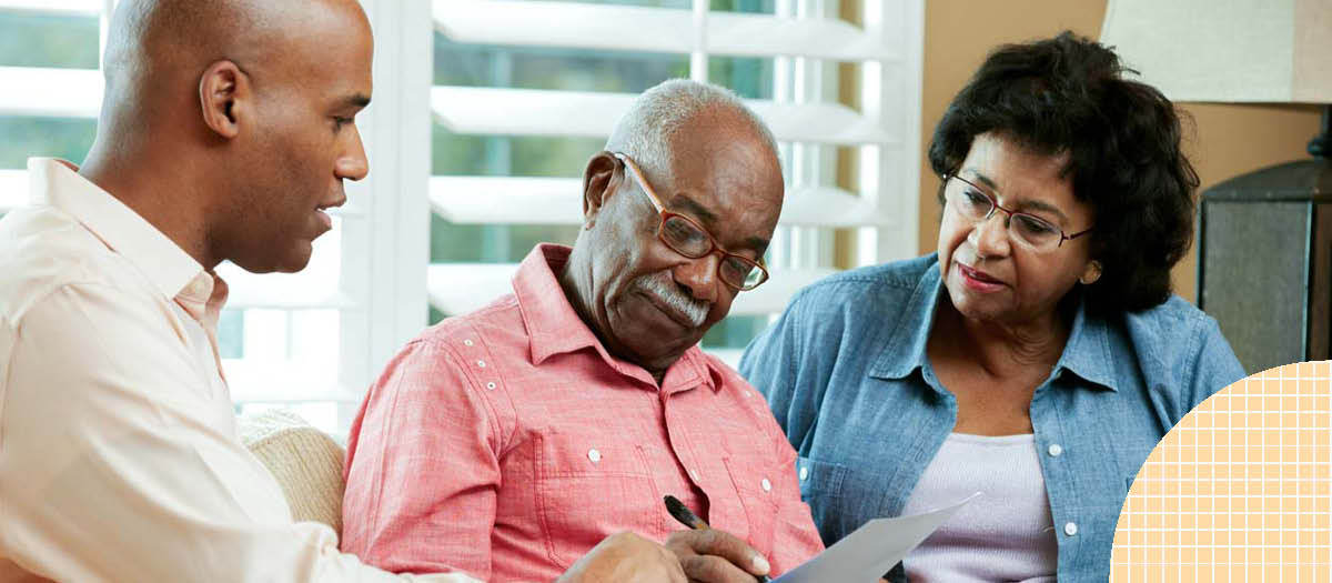 Senior couple reviewing insurance and retirement documents
