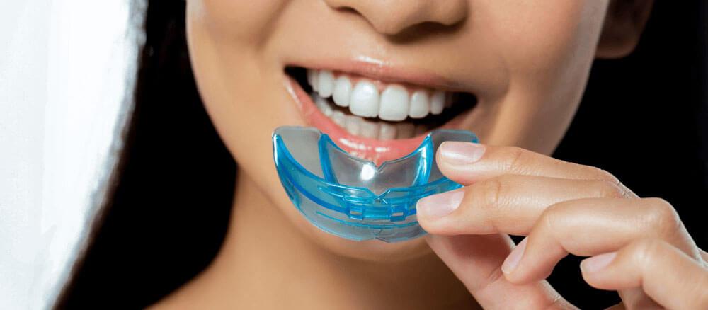 Woman using mouth guard