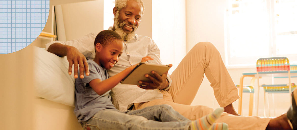 Grandfather and grandson enjoying a book