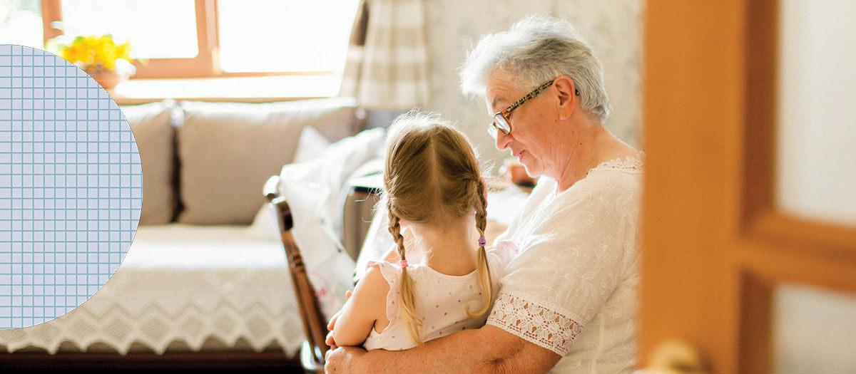 Senior woman holding granddaughter