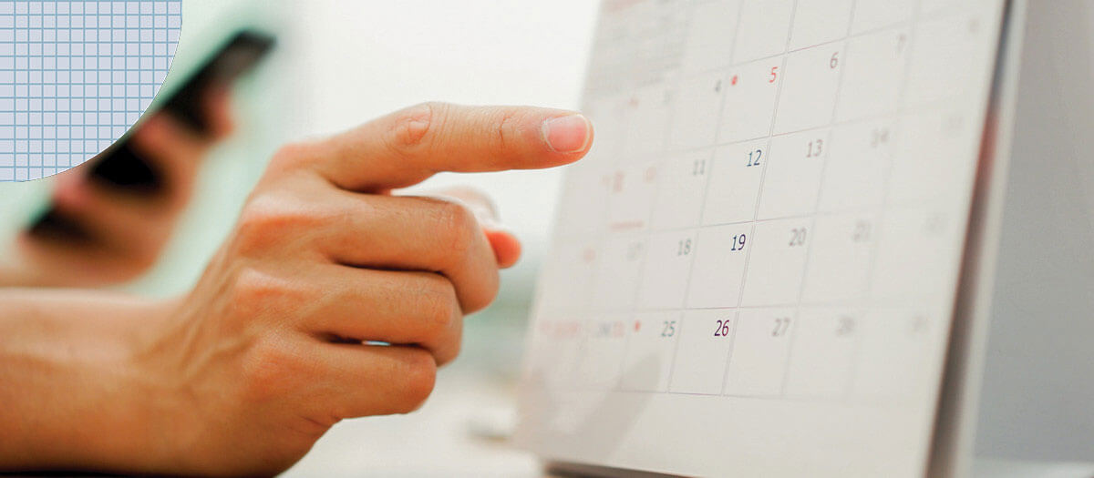 Hand pointing at calendar