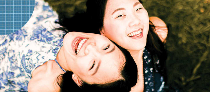 Two girls laughing and smiling