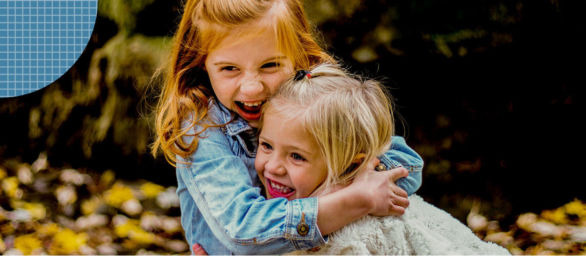 Two children hugging eachother
