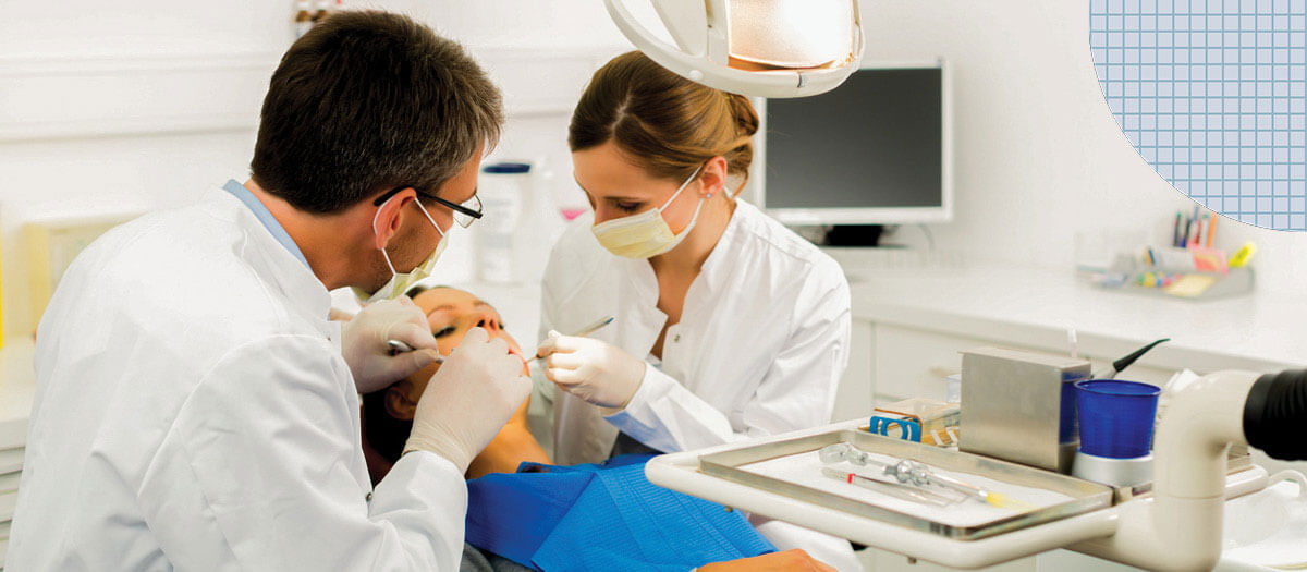 Dentists working on patient