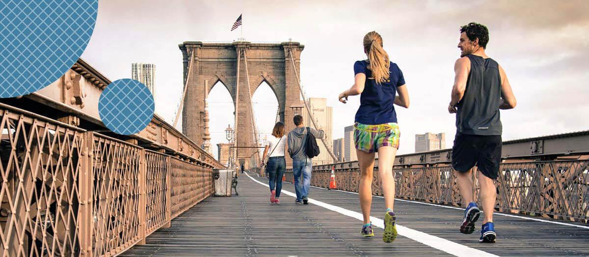 Man and Woman jogging on a bridge