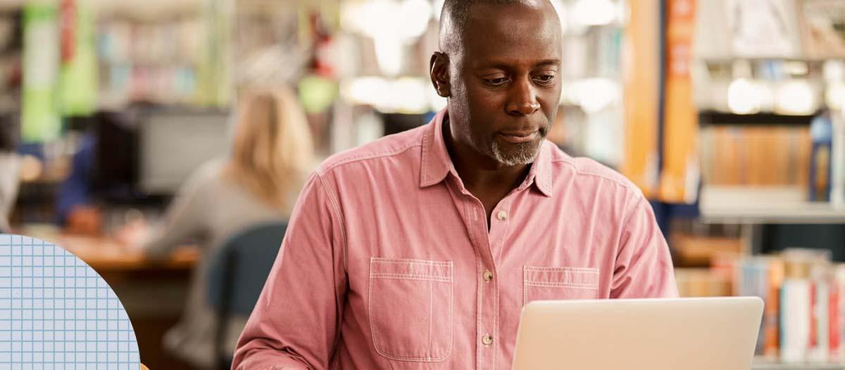 Man researching on his laptop