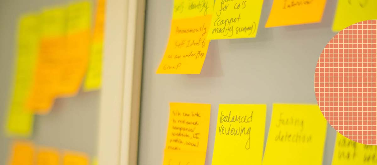 yellow sticky notes arranged on a whiteboard