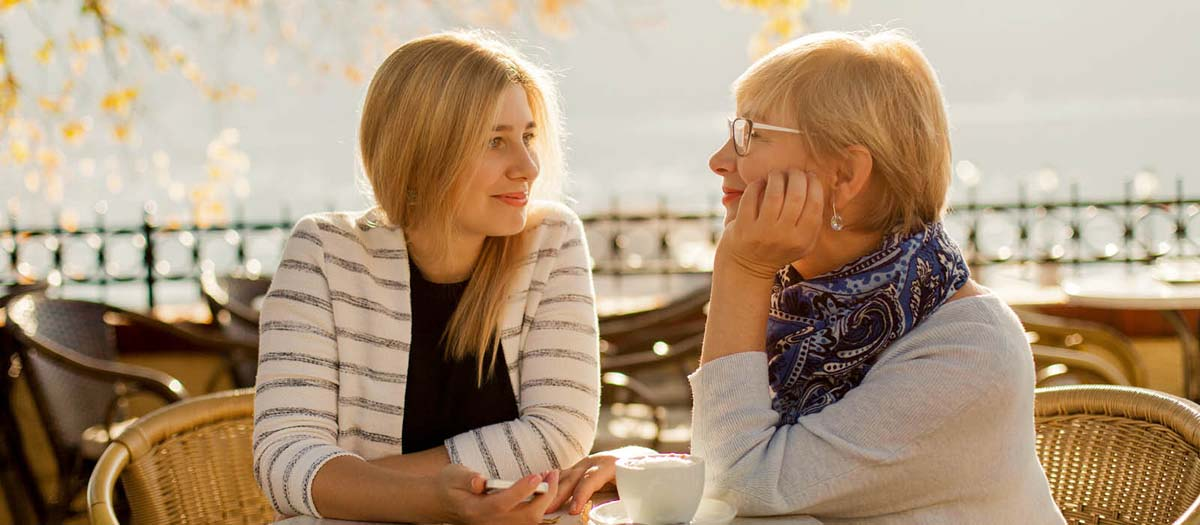 Woman sitting at table with mother