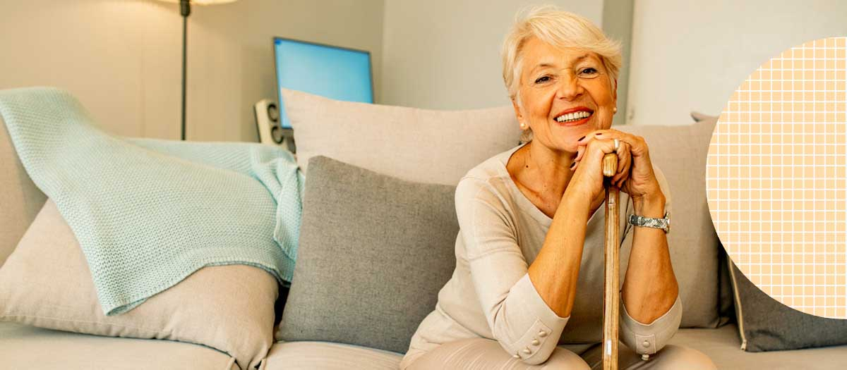 Senior Woman Sitting On Couch Smiling
