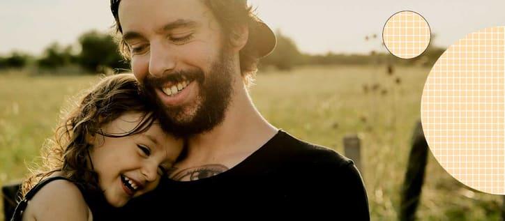 Man holding his daughter smiling