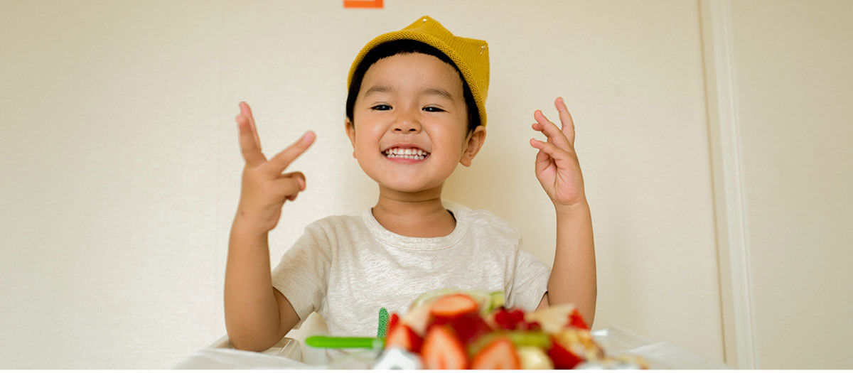 Young boy smiling at birthday party