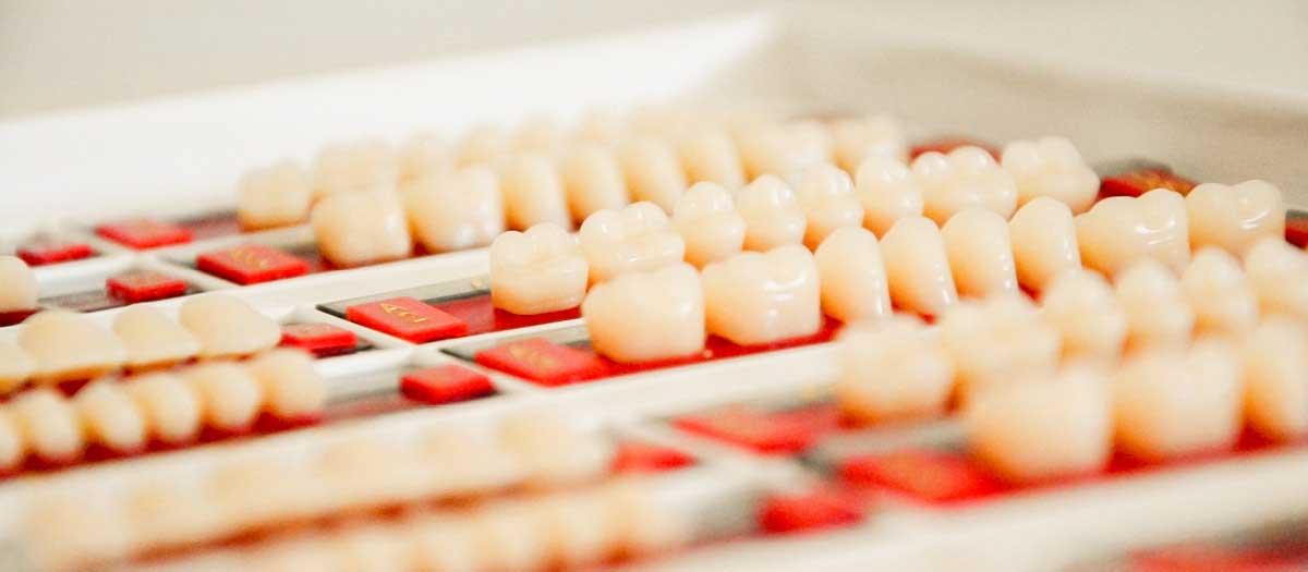 Line of dental implants on table