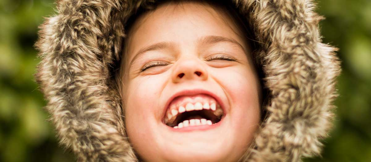 Kid with parka on smiling