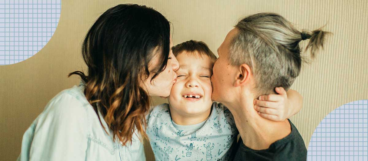 Two parents kissing their kid