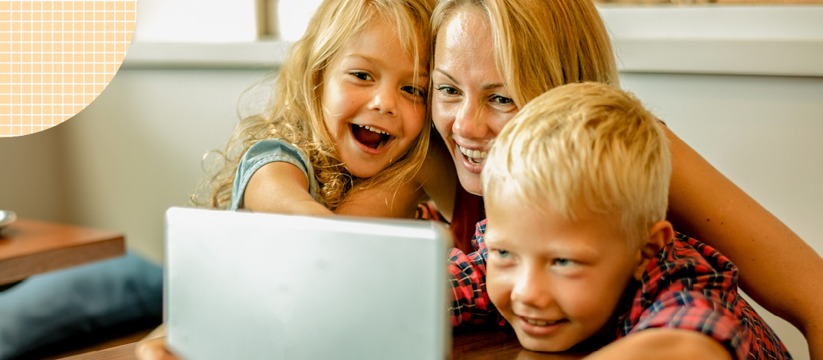 Woman with her two kids using a tablet