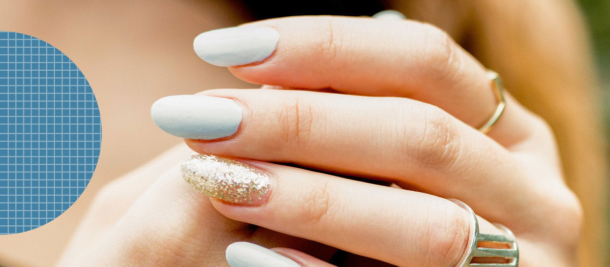 Woman's nails with blue polish