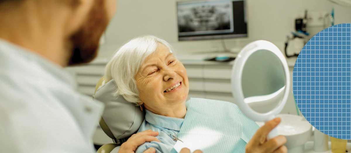 Senior woman in dental chair smiling