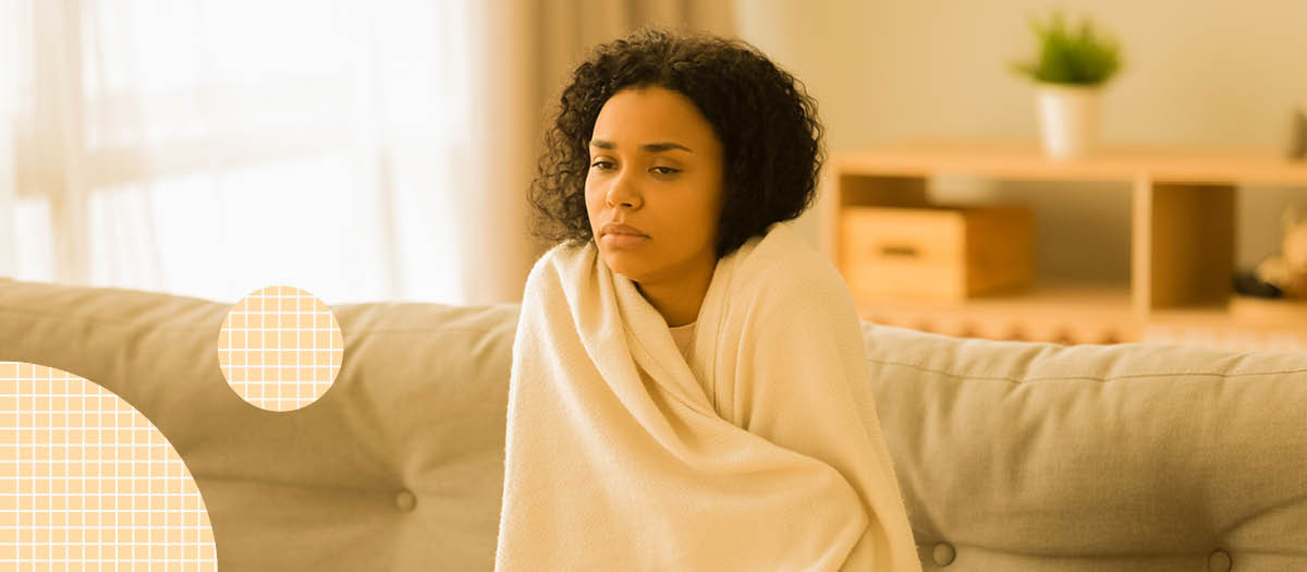 Woman wrapped in blanket feeling foggy