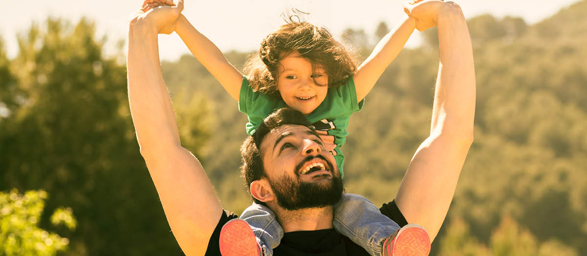 Dad with son sitting on his shoulders