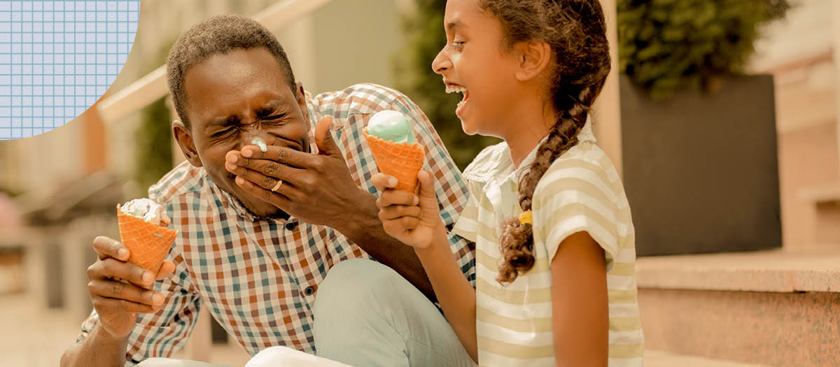 Man and daughter eating ice cream