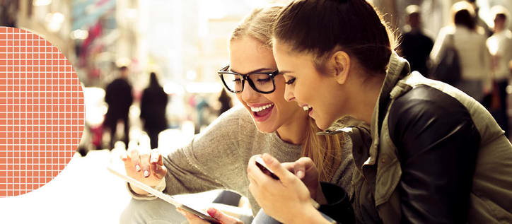 Two girls looking at iPad