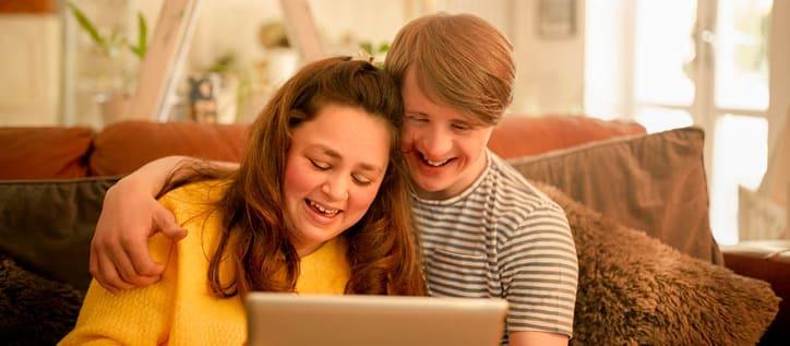 Mom and son looking at iPad