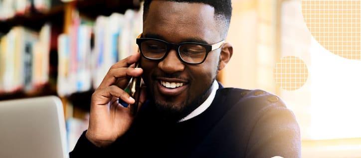Man with white teeth on phone
