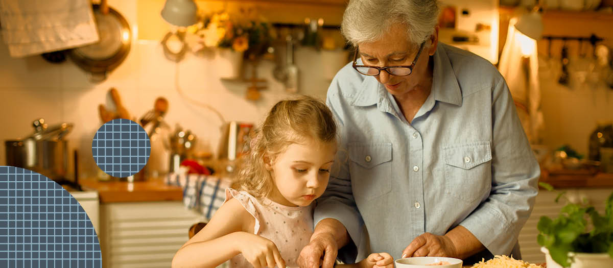 Grandma and granddaughter making snacks in the kitchen