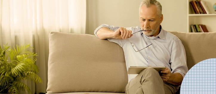 Man looking at iPad pensively