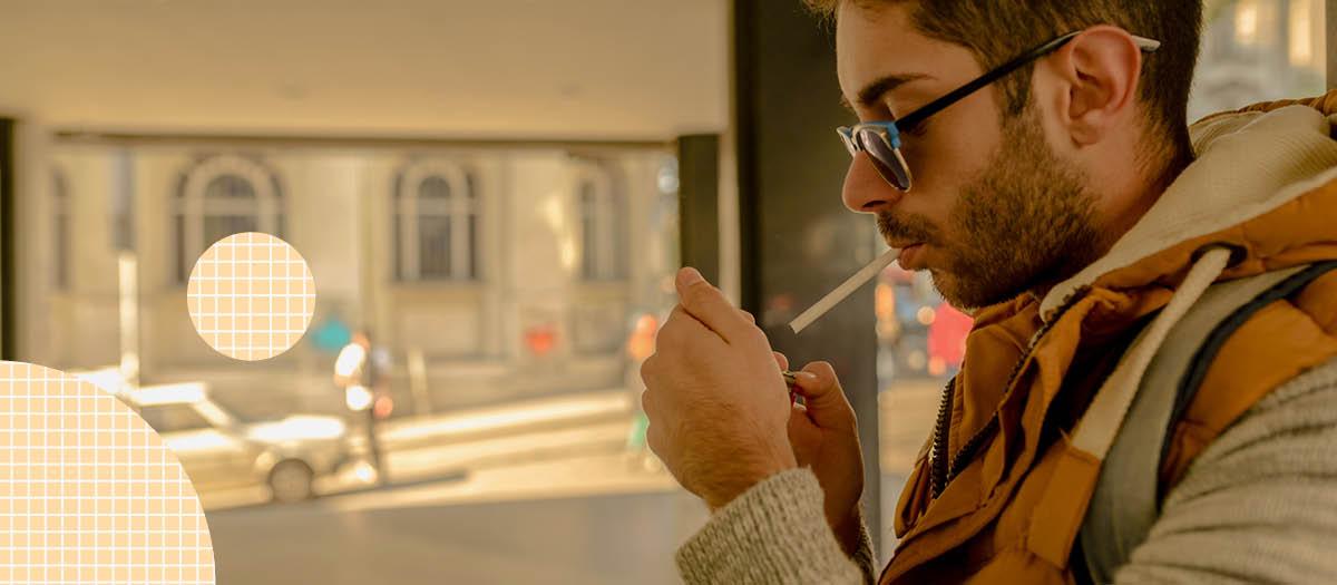 Man lighting up a cigarette outside