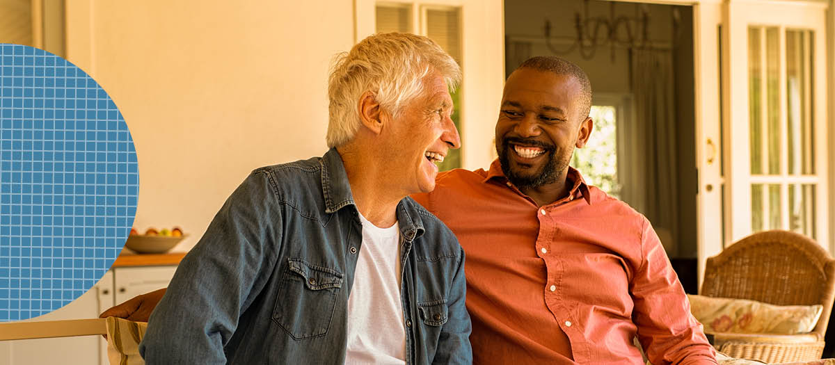 Two men laughing together