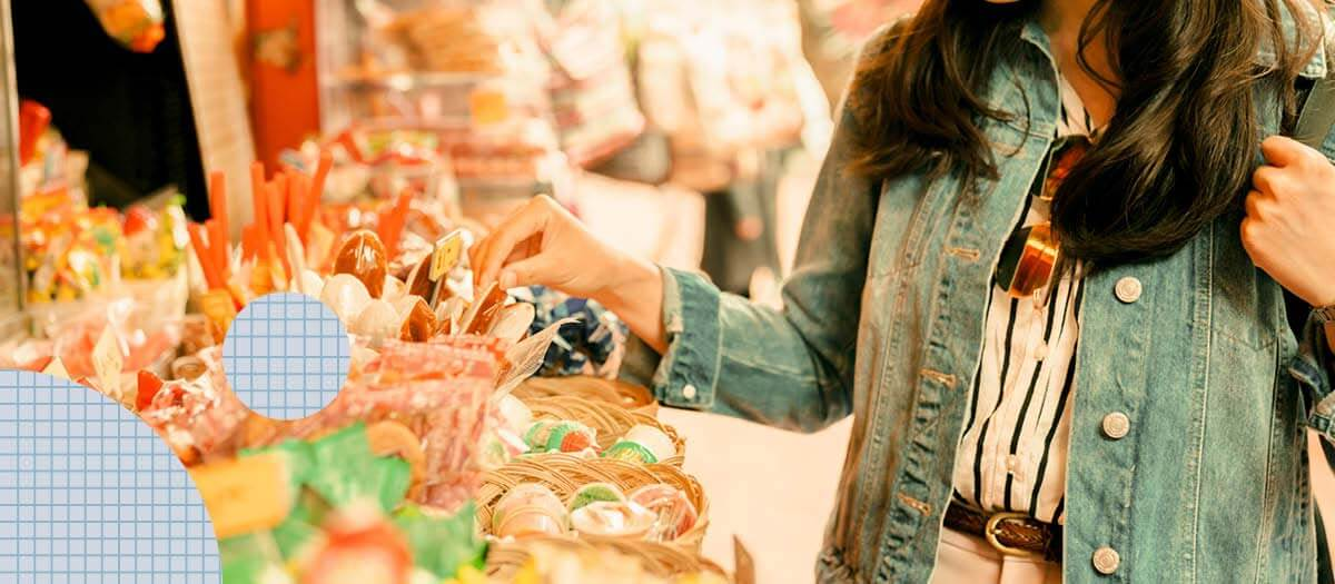 Woman picking out candy at a shop