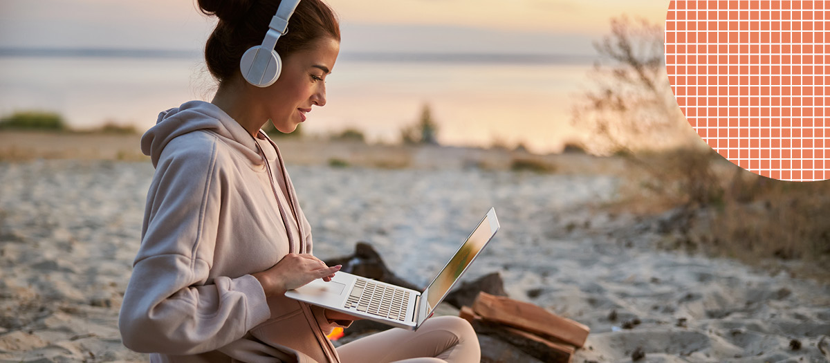cool girl with headphones on the beach researching cavities
