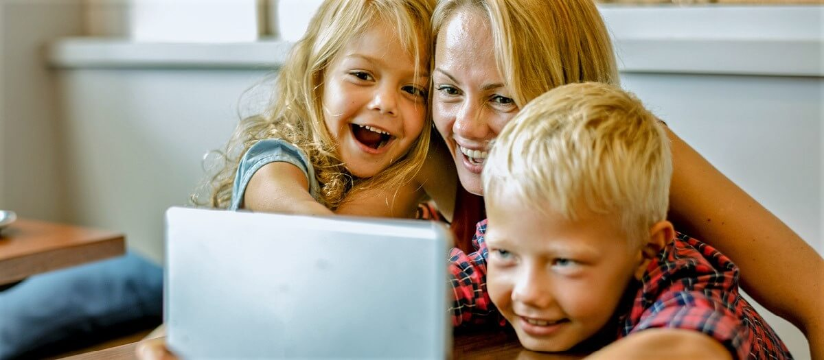 Mother and two kids watching show on tablet