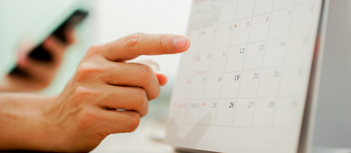 Calendar as someone schedules dental appointment