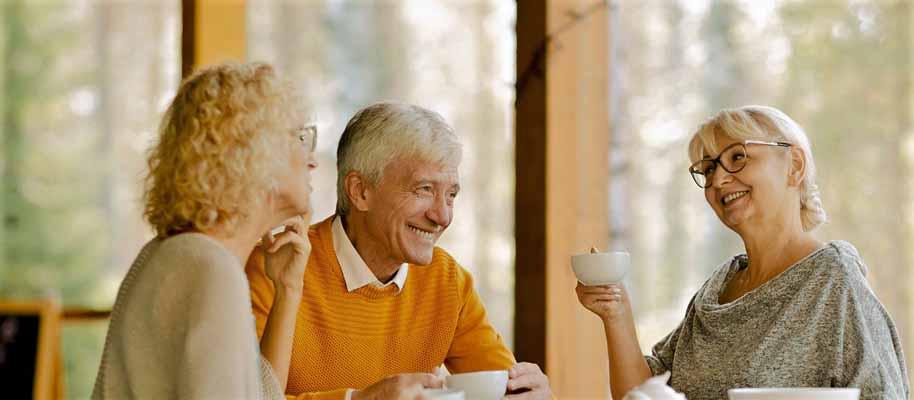 Three seniors enjoying tea together