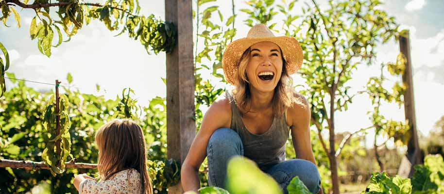 Woman in garden with her child smiling